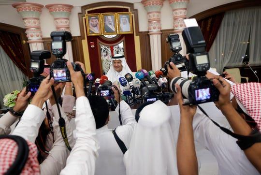 Saudi Energy Minister Prince Abdulaziz bin Salman, is surrounded by photographers as he enters a press conference in Jiddah, Saudi Arabia, Tuesday, Sept. 17, 2019.