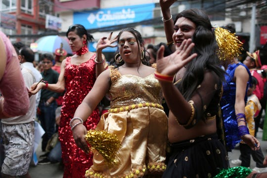 In this Aug. 16, 2019, photo, participants dance at a gay pride parade in Kathmandu, Nepal.