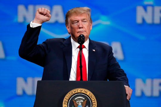In this April 26, 2019, file photo, President Donald Trump speaks at the National Rifle Association Institute for Legislative Action Leadership Forum. Negotiations on potential new firearms restrictions have been stymied while Republicans look to Trump for any idea of what he would sign.