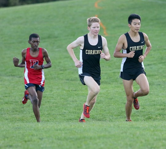 Corning senior Torrey Jacobson-Evans, center, runs behind teammate Matthew Hong on his way to a win in the boys varsity race at  the STAC West divisional cross country meet Sept. 17, 2019 at the Murray Athletic Center in Pine Valley.