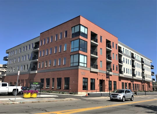 A new mixed use building on West Water Street that is the anchor of a downtown Elmira revitalization project is officially open for business.