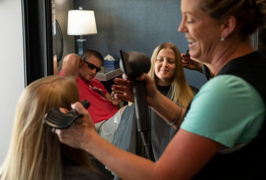 """Just having my hair brushed feels awesome,"" Jessica Schenk of Wadesville told stylist Heather Wehmer and husband, Waylon, during her visit to Pig Tails Salon on Tuesday."