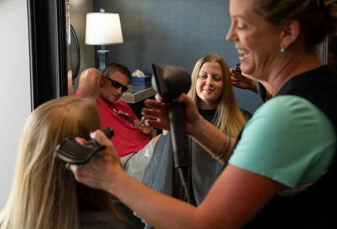 """""""Just having my hair brushed feels awesome,"""" Jessica Schenk of Wadesville told stylist Heather Wehmer and husband, Waylon, during her visit to Pig Tails Salon on Tuesday."""