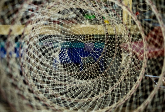 The throats are visible in one of master net maker Larry Haycraft's creations. The Petersburgh, Ind., native can tie 400 knots in an hour, but up to 600 if he gets in the right groove.