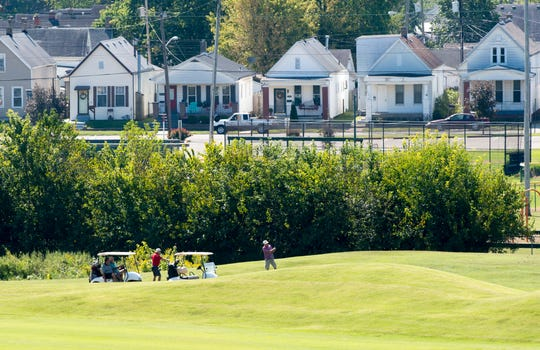 Golfers tee off on the 13th hole of Helfrich Hills Golf Course Wednesday afternoon, Sept. 18, 2019. Built in 1923, Helfrich Hills Golf Course was designed by architect Tom Bendelow and features many hills, valleys, and tree-lined fairways.