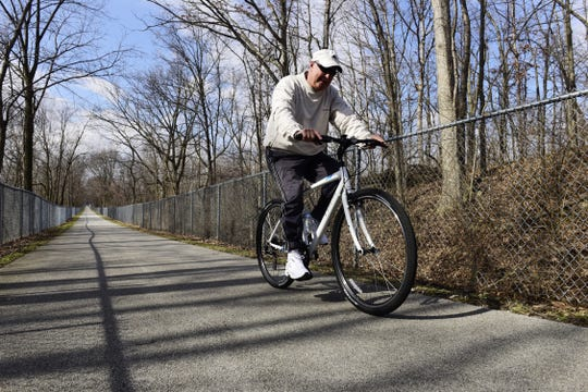 Stephen Holman of Fremont rides his bike on the North Coast Inland Trail at Walsh Park in Fremont in March 2017.  Terra State Community College is working with the Sandusky County Park District to expand the trail to the community college's campus.