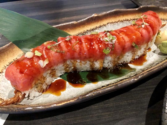 The Empire roll ($14) from Maks is filled with tempura shrimp and avocado, then topped with spicy tuna, eel sauce and scallions.