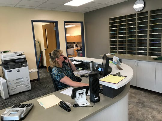 Administrative Secretary Amy Oysti answers a phone call in the new Luxemburg-Casco Primary School office, part of a new secure entrance finished in time for the 2019-20 school year. The entrance is one component of a $27.8 million renovation project encompassing L-C schools.