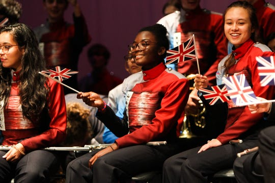 Senior Elise Calixte waves a British flag in the formal invitation ceremony at Riverside High School, Sept. 17, 2019. The ceremony opened with a sample of the band's music and ended with a formal invitation to perform in the 2021 London New Year's Day Parade.