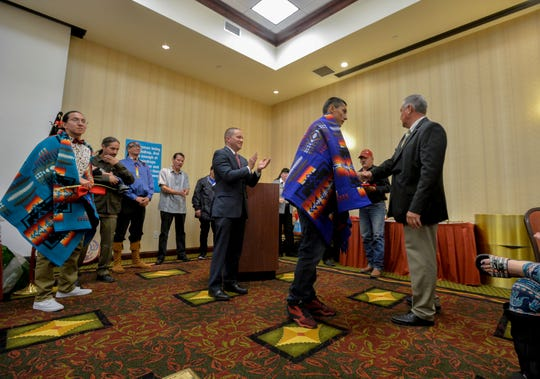 Josh Parocai is recognized during a graduation ceremony for the Eighth Judicial District Drug Treatment Court program on Tuesday afternoon at the Hilton Garden Inn, September 17, 2019.