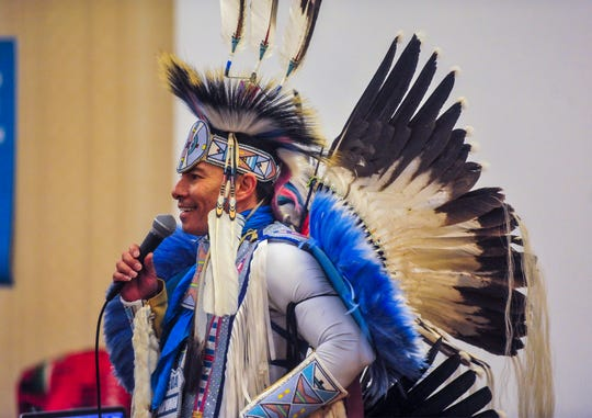 """Christian """"SUPAMAN"""" Takes Gun Parrish entertains the attendees of the Eighth Judicial District Drug Treatment Court graduation ceremony on Tuesday afternoon at the Hilton Garden Inn, September 17, 2019."""