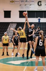 The University of Guam Tritons' Niah Siguenza jumps to start the game against the Fuetsa Women's Basketball Club in the PBS Guam Women's Basketball League Sept. 17 at the UOG Calvo Field House.