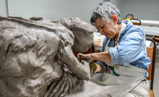 "Sandra Hinton works on her scuplture, ""The Foot Washer,"" during her sculpture class through SMAA at the McNair Building in Hattiesburg Sept. 16, 2019."