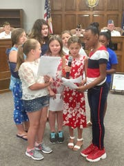 "Bend Gate fight-graders Aly Peckenpaugh, Skylar Covington, Rayli Degg, Cheyleigh Webb, Samari Dejarnett, Waverly White, Addison McCoy and Teagan Pruitt sing ""This Lane is Your Land"" during Wednesday's DAR Constitution Day program."