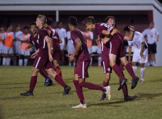 Henderson County Colonels celebrate after scoring during the Henderson County Colonels vs Hopkinsville Tigers game Tuesday evening, Sept. 17, 2019.