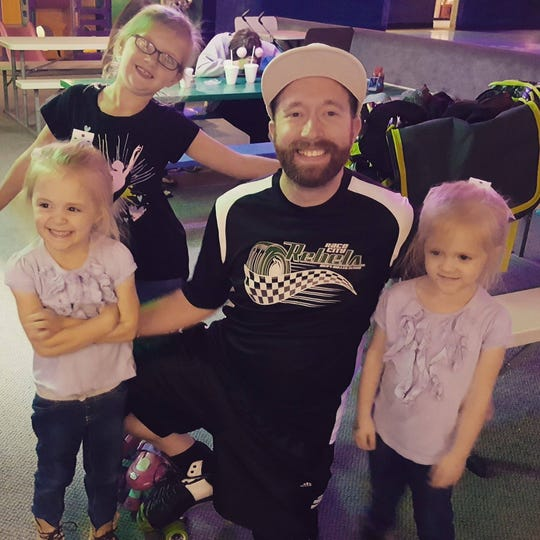 Kobi Walden poses with three of his nieces after surprising them with a trip to the skating rink.