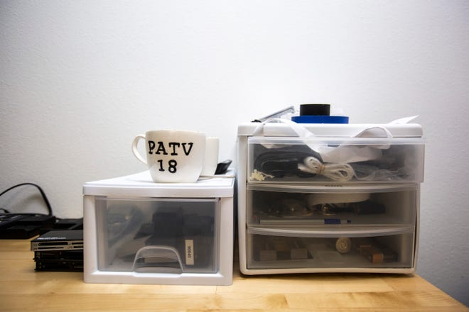 A Public Access Television channel 18 mug sits on an organizational container, Wednesday, Sept. 18, 2019, at the Public Access Television studios in Iowa City, Iowa.