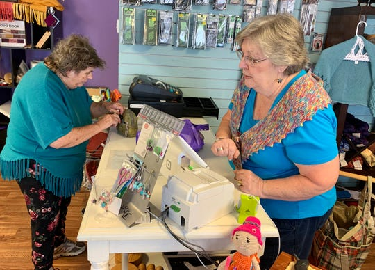 Elizabeth Buckley of Clinton, left, makes a purchase at The Southern Needle in Ridgeland with help from owner Beverly Anglin.