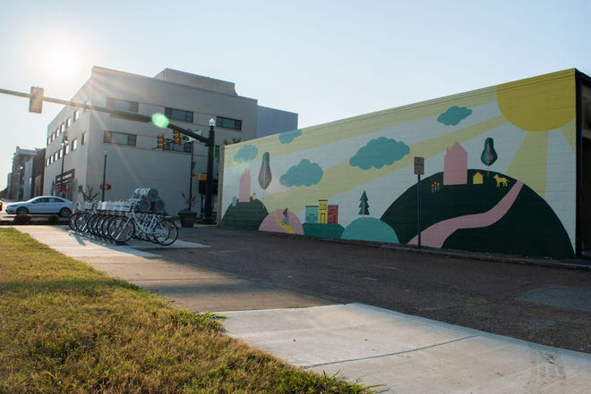 A fresh mural by Jackson resident Courtney Searcy now adorns a building on the corner of West College Street and North Highland Avenue in Jackson, Tenn., Wednesday, Sept. 18, 2019.