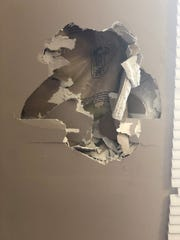 A photo taken in June shows a hole in the wall in Alumni Hall at Lane College.