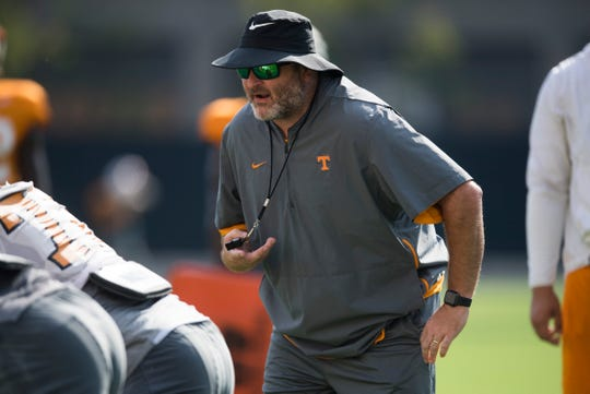 Offensive line coach Will Friend coaches during a University of Tennessee Vols football practice Wednesday, Sept. 18, 2019.