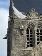 A dummy hangs from the church roof at Sainte-Mere-Eglise, depicting the experience of paratrooper John Steele of the 82nd Airborne during the D-Day invasion of Normandy in 1944.