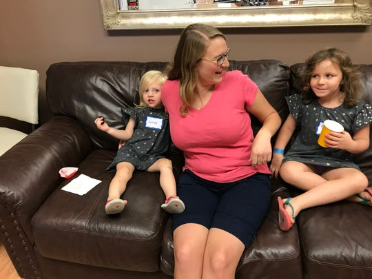 Emily Ruoti, center, laughs with her daughters Lizzie, 2, and Esther, 4, at the grand opening of a new milk depot at Knoxville Lactation Clinic in West Knoxville. Ruoit, also mom to 6-week-old Jacob, donated milk while breastfeeding her older children and plans to do so again.