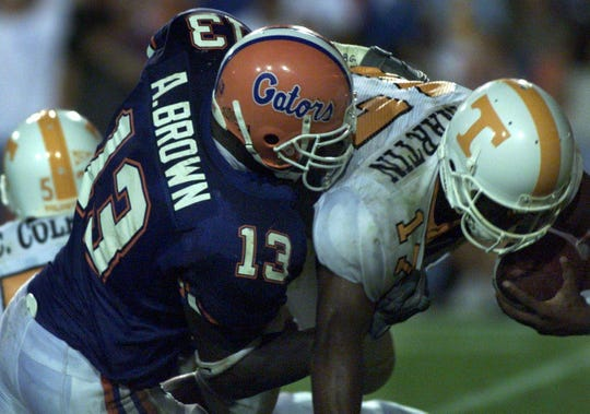 Tennessee quarterback Tee Martin is sacked by Florida defensive end Alex Brown (13) during the third quarter of their game Sept. 18, 1999.