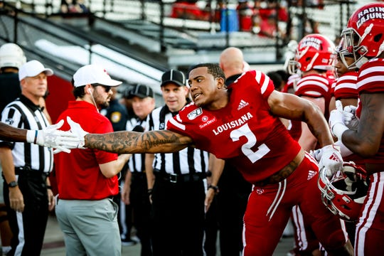 Linebacker Lorenzo McCaskill, from Detroit, slaps a hand during UL's win over Texas Southern last Saturday.