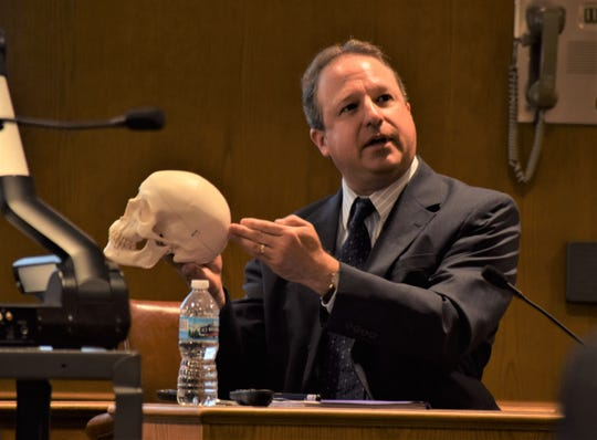 Charles J. Lee, a chief forensic pathologist and deputy coroner with the Licking County Coroner's office, points to where an entry wound was found on John Letourneau's body, caused by a shotgun. Lee was testifying in the jury trial of Raeqwan Hancock, who is accused of murdering Letourneau in 2018.