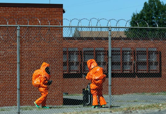 Members of the Ohio National Guard's 52nd Civil Support Team sweep the outside of an unused building Wednesday, Sept. 18, 2019, at the Southeastern Correctional Institute in Lancaster. Members of the guard team were practicing with the Ohio Department of Rehabilitation and Correction and the Ohio Highway Patrol on a response to a hazardous material being released inside a prison cellblock.