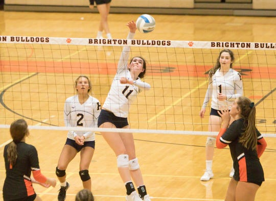 Hartland's Chloe Vestergaard (11) spikes the volleyball against Brighton on Tuesday, Sept. 17, 2019.