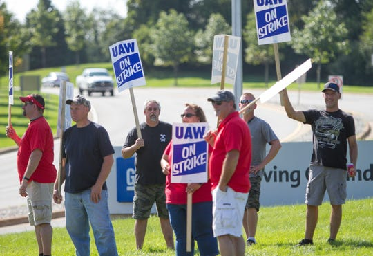 UAW union members picket in front of the GM's Milford Proving Grounds, Wednesday, Sept. 18, 2019.