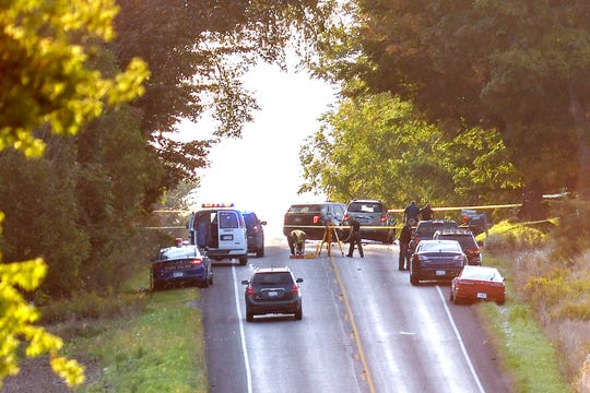 Police work the scene of a crash involving a horse-drawn Amish cart carrying four siblings on Wednesday, Sept. 18, 2019, in Chester Township in Eaton County near Charlotte. The children were ages 6 to 13; three died and a fourth was critically injured.