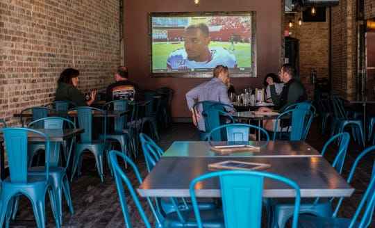 Several large TVs are in use at the recently opened The Rusty Mug Bar & Grill REO Town Saturday, Sept. 14, 2019.