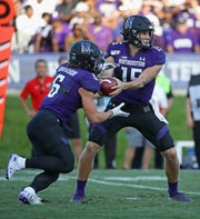 Northwestern QB Hunter Johnson, right, hands off to running back Drake Anderson during the Wildcats' 30-14 home win over UNLV last weekend. Drake Anderson is the son of former Northwestern great Damien Anderson.