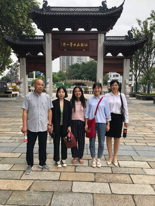 Zoe Halbeisen (center) with her birth father Chen Xin Zhong, sisters Chen Hong and Chen Lin and her birth mother Wang Xu Mei in China. Zoe met them all for the first time less than a month ago.
