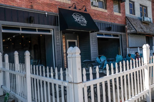 The Rusty Mug Bar & Grill REO Town features large, garage doors and a fenced in patio Saturday, Sept. 14, 2019.