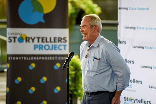 David Waymire, a public relations guru, speaks on stage during the Lansing Storytellers Project: 'Bad Advice' event on Tuesday, Sept. 17, 2019, at the Lansing Center's Riverfront Plaza in downtown Lansing.