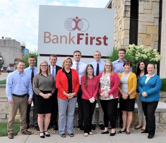 Manitowoc-based Bank First has announced it has exceeded $300,000 in tuition reimbursement since introducing the program in 2015, helping 23 employees obtain degrees of higher education.