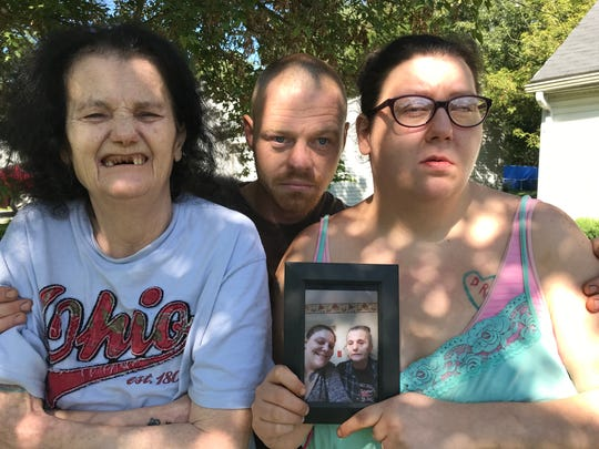 Betty Cooley, at left, Ashlee Stull's stepmother, David Brock, and Ashlee's sister Amber Craig, holding a photo of her late sister and Cooley, want justice for Ashlee who died of an overdose on Oct. 4, 2018.