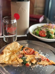 Grab a slice of Aldo's pizza of the day and a side salad for a quick lunch under $10.