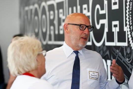 Al Gossett of Gossett Motors chats with guests at Moore Tech's new automotive repair facility, built in a partnership with local auto dealerships who are seeing an impending shortage in labor for mechanic positions, as they celebrated their opening on Wednesday, Sept. 18, 2019.