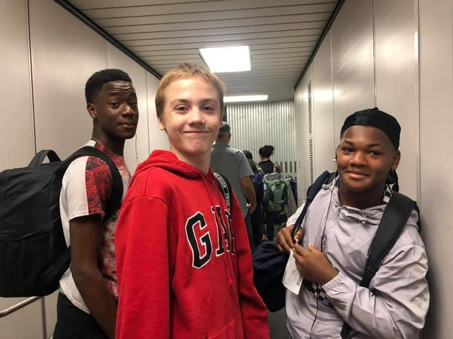 Martin Luther King College Prep students Antwain, Micheal and Kristopher (from left to right) will appear on Ellen on Friday, according to the school.