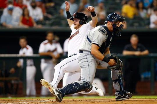 Sacramento River Cats Joe McCarthy slides in safely past Columbus Clippers catcher Ryan Lavarnway during the first inning of the Triple-A National Championship at AutoZone Park in Memphis, Tenn. On Tuesday, Sept 17, 2019.