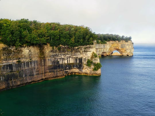 Grand Portal arch and mineral-stained sandstone cliffs are visible along the North Country Trail in Pictured Rocks National Lakeshore on Sept. 15, 2019.