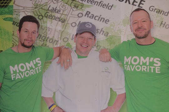Photos of the Wahlberg family decorate the restaurant.