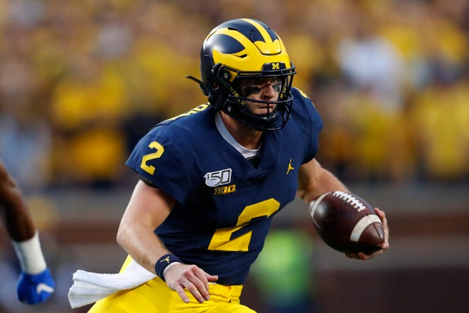 The Badgers know Michigan quarterback Shea Patterson is a threat to run even though he is overcoming a recent oblique injury.
