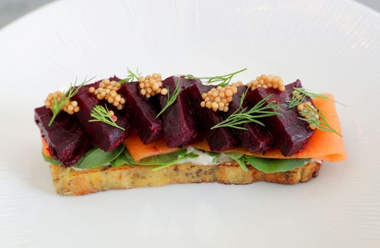 Beet is smoked and seasoned to taste like pastrami in this appetizer at Buckley's Restaurant.