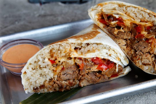 The adoborrito from Filipino food stand Meat on the Street holds shredded pork adobo, garlic rice, red pepper and onions.